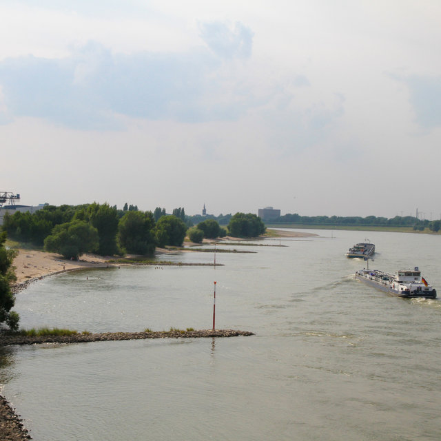 Cargo ships going up the Rhine.