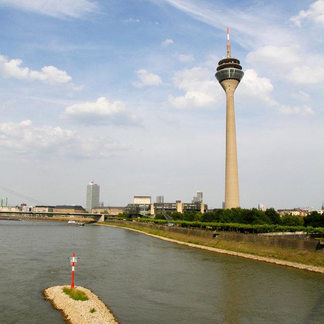 Rheinturm and harbour inlet seen from the pedestrian harbour bridge.