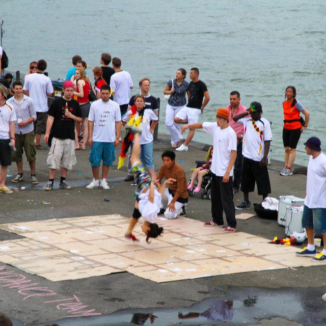 Breakdancers performing near the Rhine.