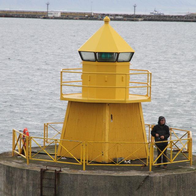 Fisherman at Reykjavík harbour exit.