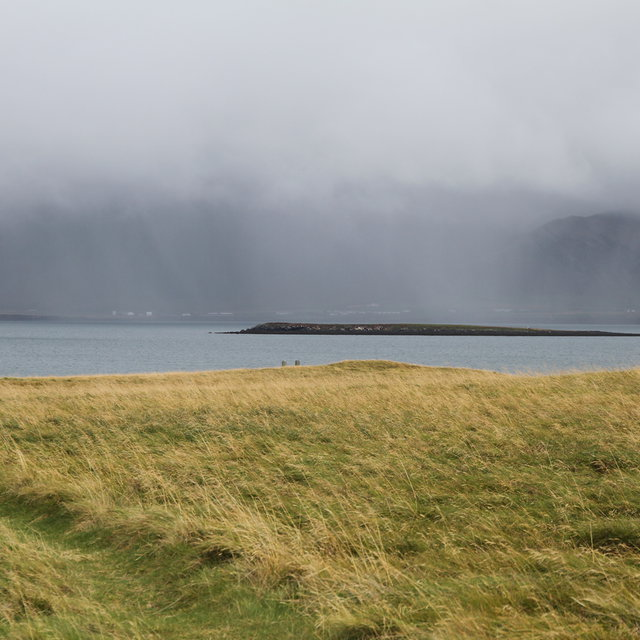 View from Viðey island towads the the cloud covered mountain Esjan.