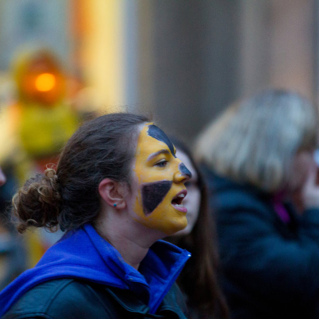 Protester with the ionising radiation hazard symbol painted on her face.