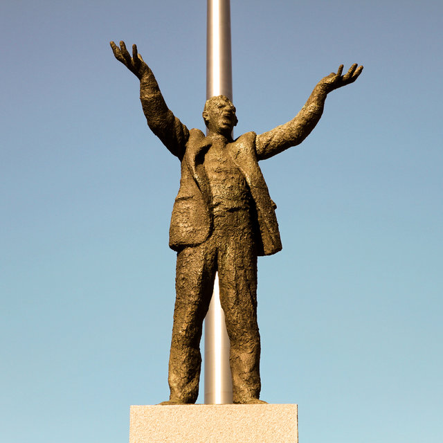 Statue of Jim Larkin in front of the Spire of Dublin.