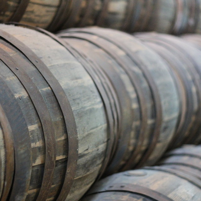 Stacked Guinness barrels.