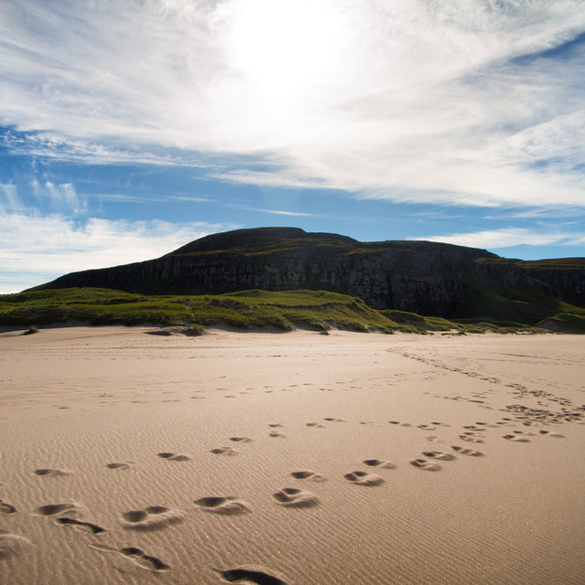 Footprints on Sandwood Bay beach.