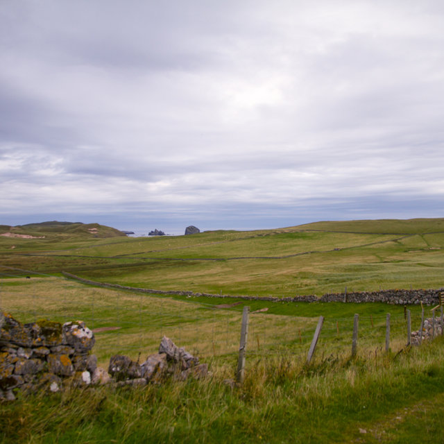 View over the fields of Durness onto the ocean.