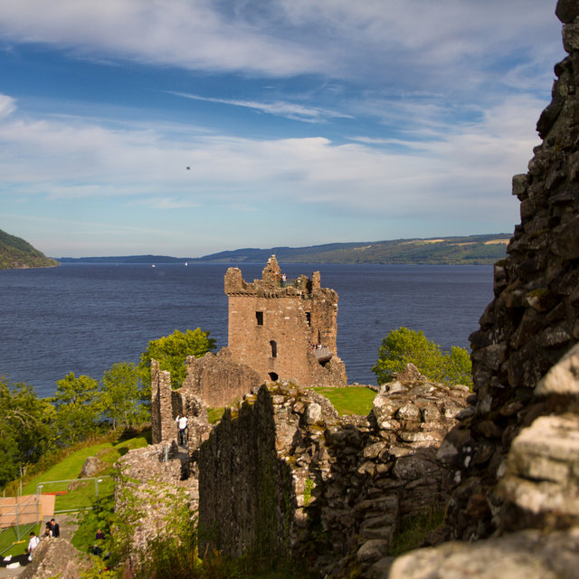 The Urquhart Castle Grant Tower with Loch Ness in the background.