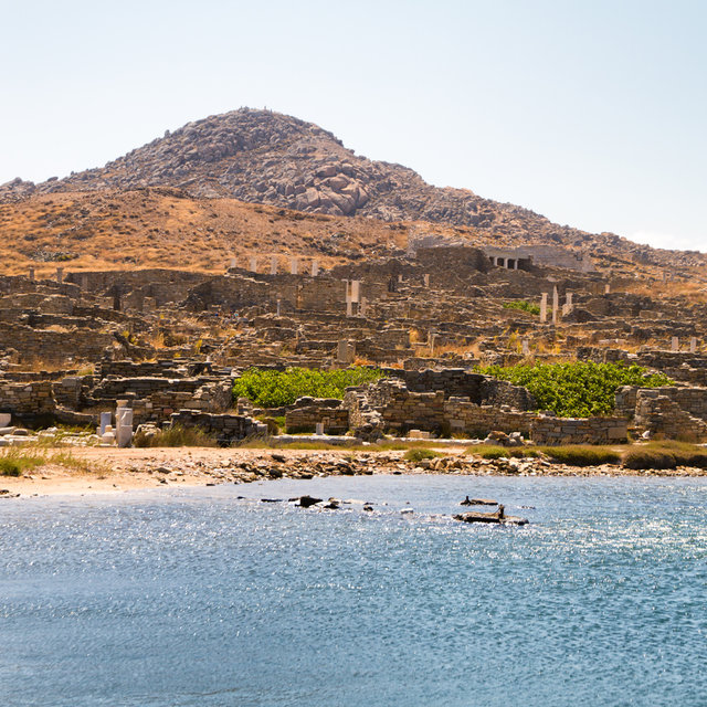 View of the ruins around the Archaeological Museum of Delos from the sea.