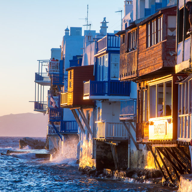 Houses directly facing the sea during sundown.