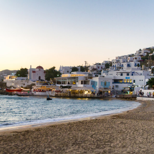 Beach and houses in Mykonos city.