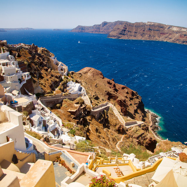 Steps leading down to the ocean in the village of Oia. Fort Londosa is situated at the top of the cliff.