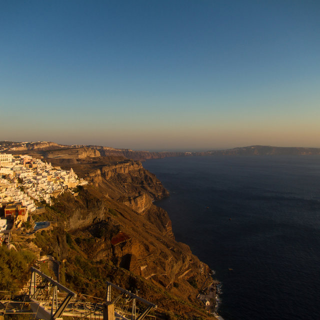 View along the coastline of Santorini. Firá can be seen on the left side.