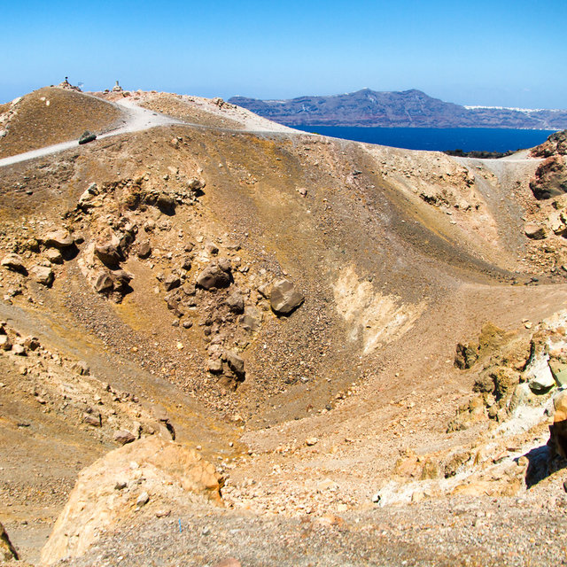 The volcanic crater on Nea Kameni. The village of Akrotiri can be seen in the background.