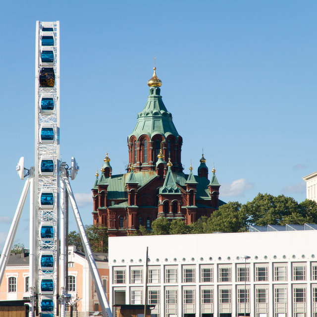 View from the sea towards the orthodox Uspenski Cathedral and the Finnair skywheel.