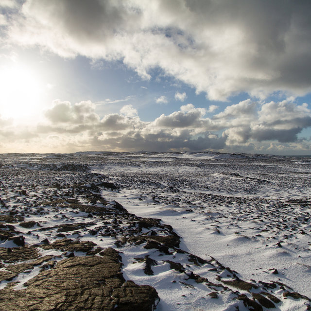 View over the snow-covered lava plains of Reykjanes peninsula.