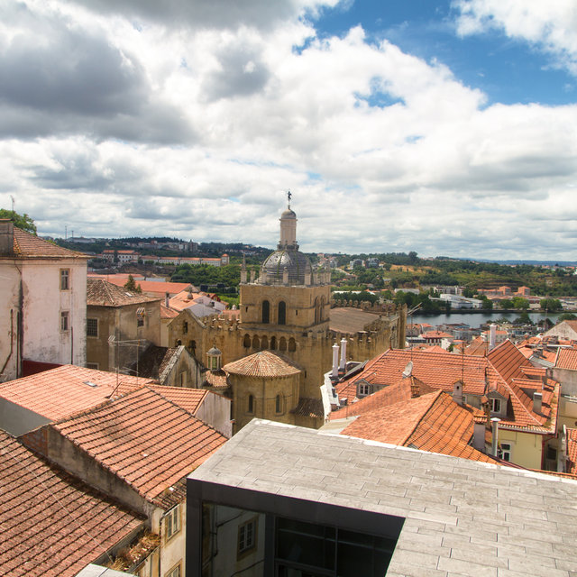 View from the Museu Nacional de Machado de Castro over the roofs and towards the Old Cathedral of Coimbra.