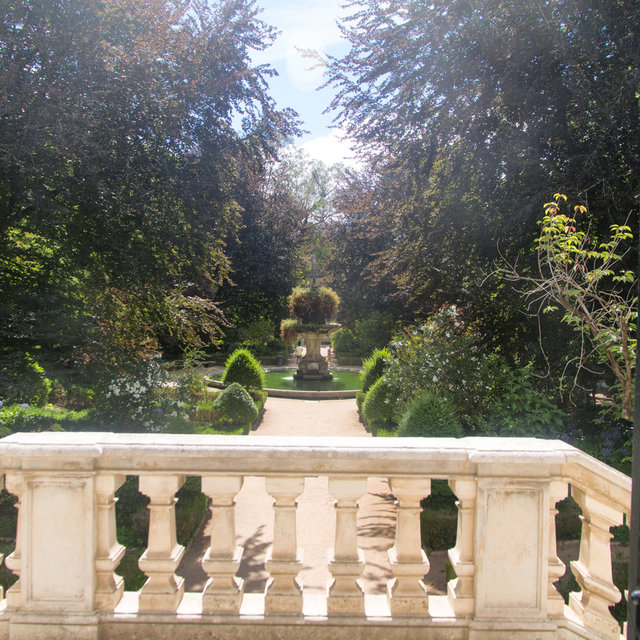 View from an entrance towards a fountain in the the Botanical Garden of the University of Coimbra.