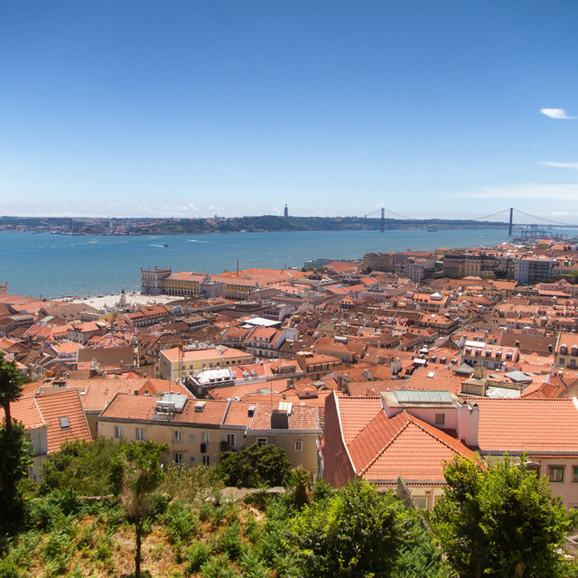 View from the São Jorge Castle over the roofs of Lisbon towards the Christ the King statue.