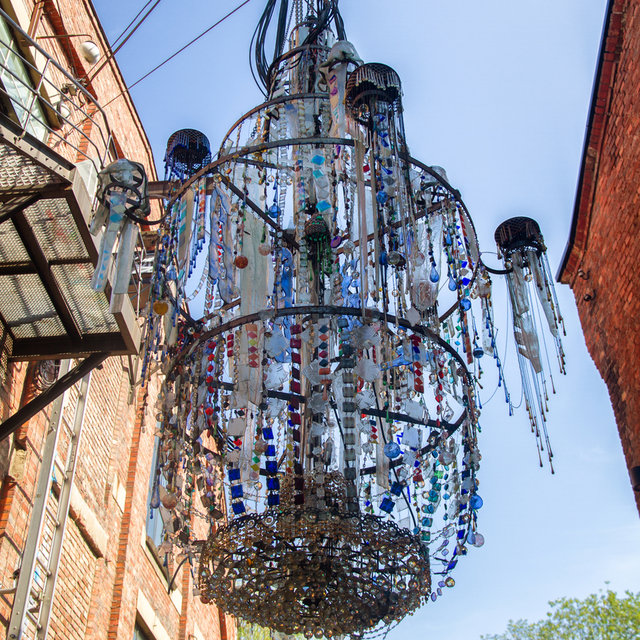 A chandelier hanging between two old factories in Grünerløkka.