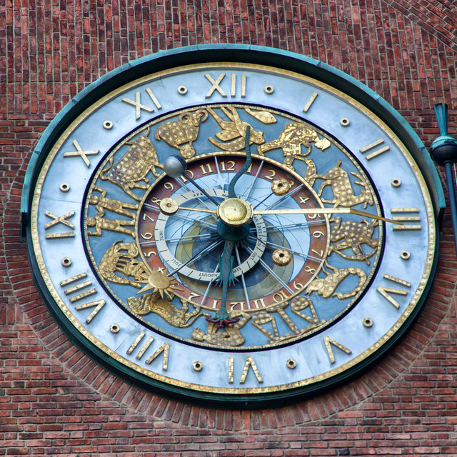 The astronomical clock on the north side of the Oslo City Hall.